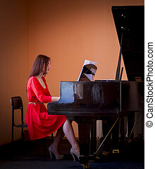 Pianist - Woman in red dress playing grand piano