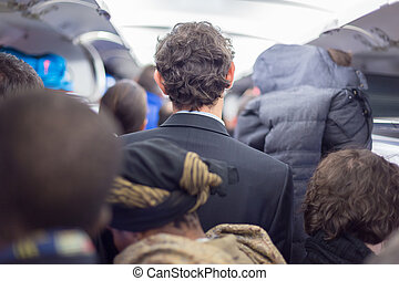 Peoplle disebarking the airplane - Interior of airplane with...