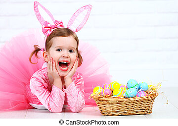Happy child girl in a costume Easter bunny rabbit with...