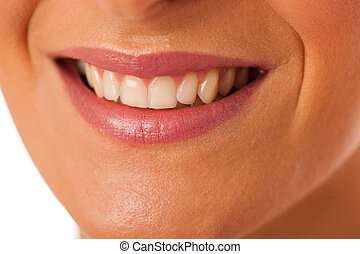Clean healthy white teeth of smiling happy woman.