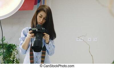 Female photographer working in the studio