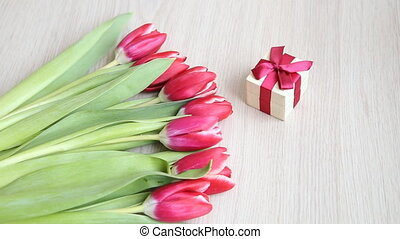Lay flowers next to the present. Flowers move from frame to...