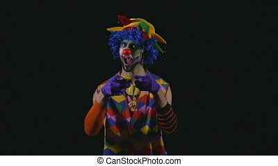 Young hilarious clown juggling in slow motion