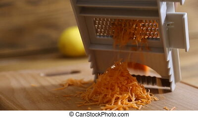 cutting carrot grater close up