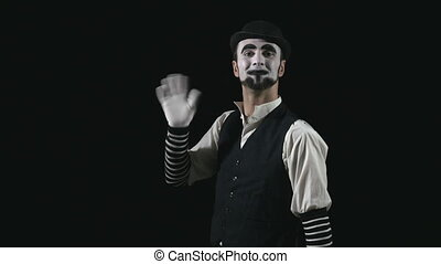 Young funny mime pointing and performing a comedy pantomime...
