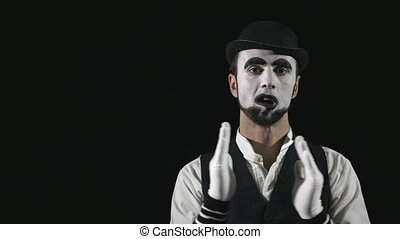 Young hilarious mime making funny faces