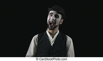 Young happy and funny mime being romantic and saluting an...