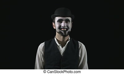 Young scary crazy evil mime