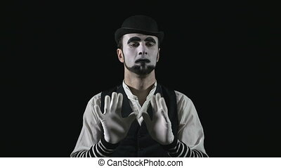 Young funny hilarious mime laughing