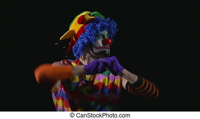 Hilarious clown making funny faces - Young hilarious clown...