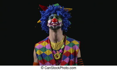 Young hilarious happy and funny clown being romantic making...
