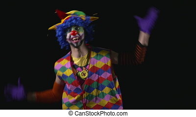 Young happy hilarious funny clown making funny faces
