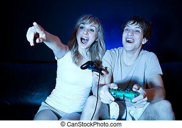 Couple playing video games - A shot of a young couple...