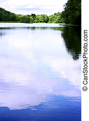 Beautiful Lake - The reflection of the sky in a beautiful...