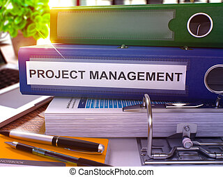 Project Management on Blue Office Folder. Toned Image. -...