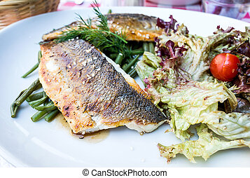 french cuisine dish with many vegetables - grilled seafood...