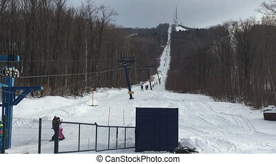 Working ski lift in snowy mountains