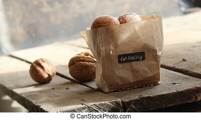 eat healthy text and walnuts on rustic old wooden table