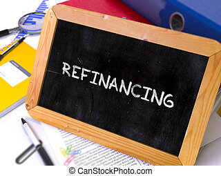 Handwritten Refinancing on a Chalkboard. Composition with...