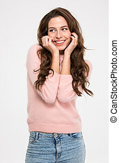 Happy cute woman posing isolated on a white background