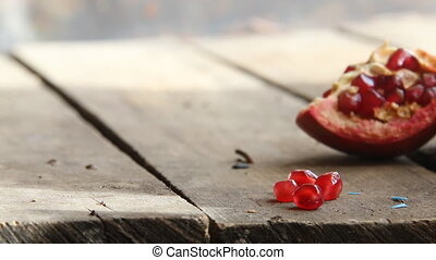 Ripe pomegranate fruit on wooden table