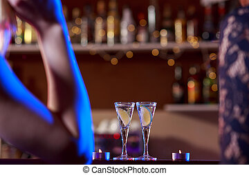 Two little glasses - Two little liqueur glasses on bar in...