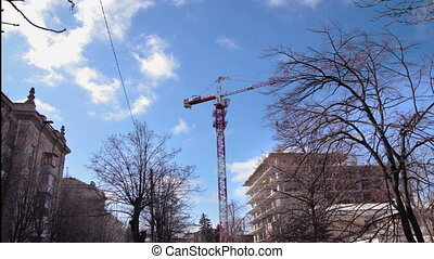 Tower crane on a construction site. Timelapse - Tower crane...