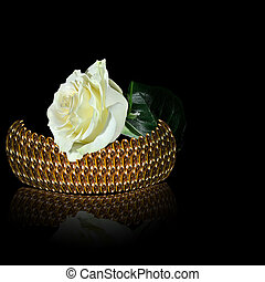 Gold bangle and white rose on the black background - Gold...