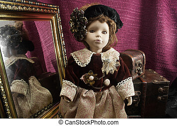 Retro fashioned porcelain doll. - Composition of a retro...