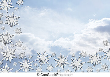 White Snowflakes with Clouds Background with copy-space for...