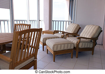 high end lanai - view of outside furniture on screened in...