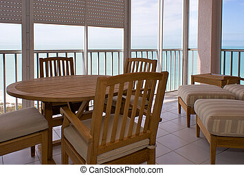 high end florida lanai - view of wooden table and outdoor...