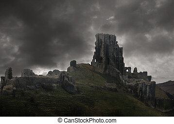 Storm above castle ruins - The ruins of Corfe Castle in...