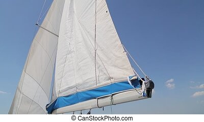 Soaring sail against the sky
