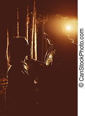 Silhouettes of medieval knight in heavy armor and his...