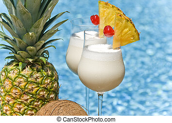 Pina Colada by the Pool - Two glasses of Pina Colada by the...