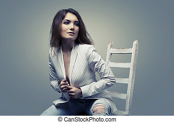 stylish woman - stylish slim woman, wearing a jacket,...