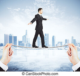 Man balancing on a tightrope concept