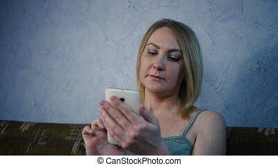 Smartphone girl using app on phone drinking coffee smiling...