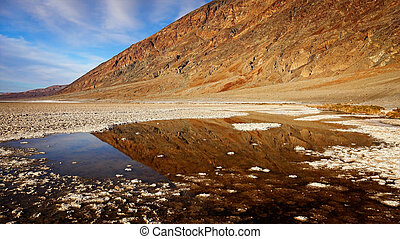 Pool of Water in Badwater Basin in Death Valley - A small...