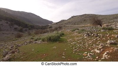 4K Aerial, Flight over the fields of Colmenar, Andalusia,...