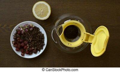 Putting tea into a teapot