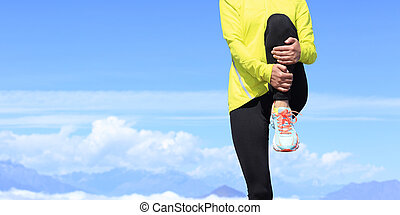 young fitness woman runner stretching before running on...