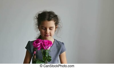 girl teen smelling a rose flowers on a white background -...