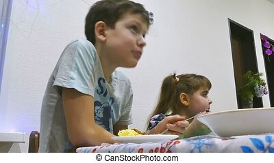 children eat 7 - boy teen at table eating meat chop holiday...