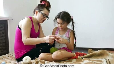 woman and teen girl knitting knit needlework lifestyle -...
