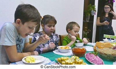 children eat at the feast - Children eat family breakfast...