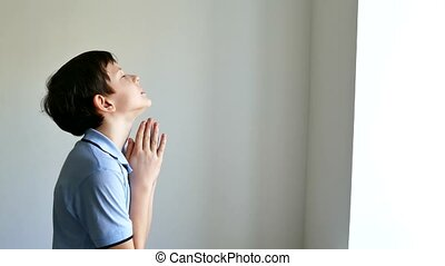 boy teen praying church belief in god - boy teen praying...