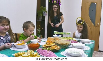 children eat 5 - Children eat family breakfast boy and girl...