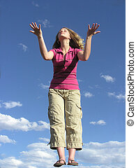 Teen in Prayer - Teenager in praise with blue sky